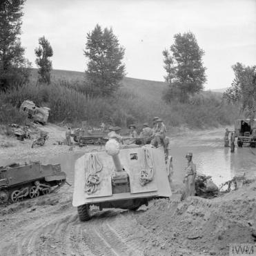 (IWM Caption) A 17-pdr anti-tank gun of 269 Battery, 87th Anti-Tank Regiment is towed across the River Foglia during the assault on the Gothic Line, 1 September 1944.